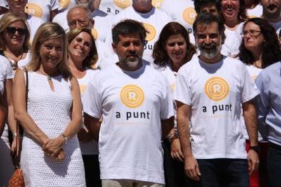 La presidenta de l'AMI, Neus LLoveras, el president de l'ANC, Jordi Sànchez, i el d'Òmnium Cultural, Jordi Cuixart. ACN